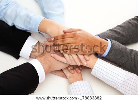 business, succcess and winning concept - group of businesspeople celebrating victory - stock photo