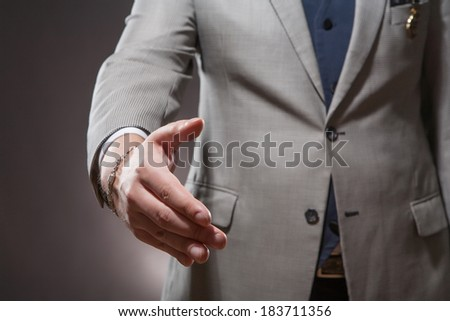 Business success and cooperation. Businessman takes his hand for a handshake. - stock photo