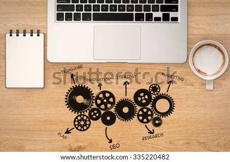 business success concept with office desk top view - stock photo
