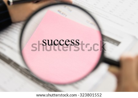 business success concepts. Business people using a magnifying glass. - stock photo