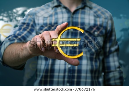 Business success strategy concept.Young man with currency sign in hands on world map background - stock photo