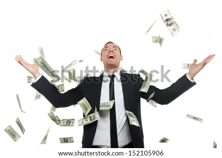 Business successful. Happy young man in formalwear standing isolated on white while money falling at him