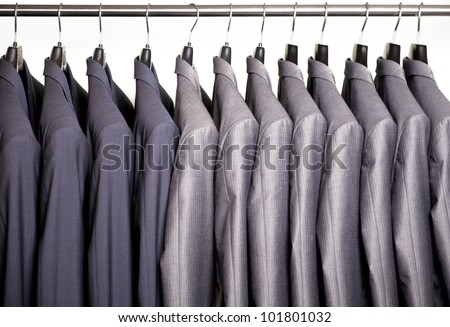Business suits hanging on a rack - stock photo