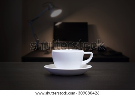 business table with a cup of coffee - stock photo