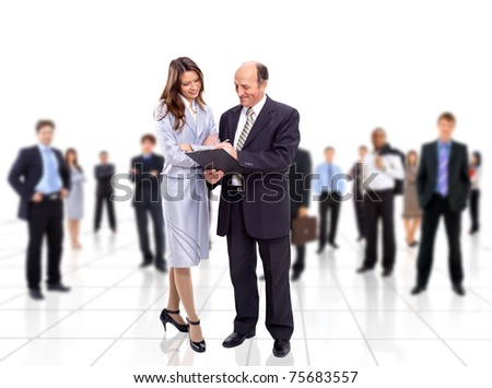 Business team and a leader - Mature business man with his colleagues in the background - stock photo