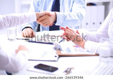 Business team are showing unity with their hands together - stock photo