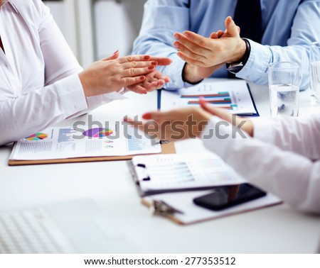 Business team are showing unity with their hands together