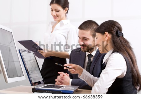 Business team at a meeting in a light and modern office environment - stock photo