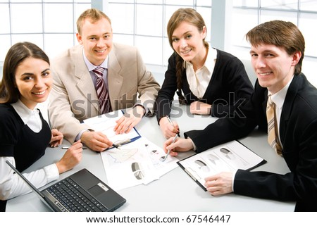 Business team at a meeting in a light and modern office environment