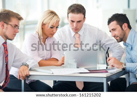 Business team at work with laptop on an office table