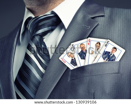 Business team cards in suit pocket - stock photo