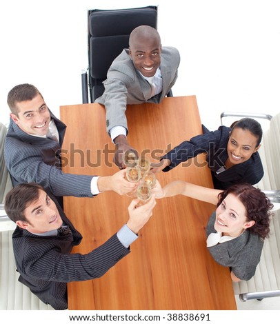 Business team celebrating a success with champagne in a meeting - stock photo