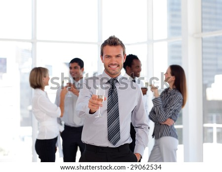 Business Team Celebrating Success with Champagne - stock photo