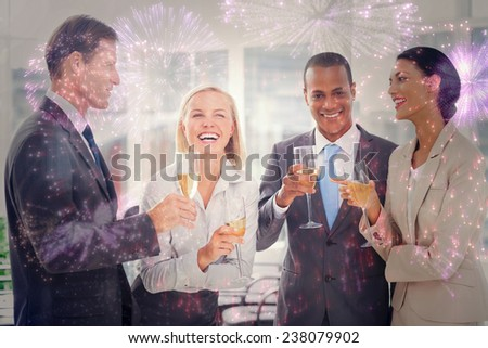 Business team celebrating with champagne against colourful fireworks exploding on black background - stock photo