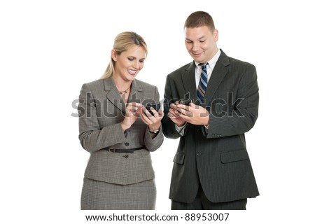 Business team checking their smart phones isolated on a white background - stock photo