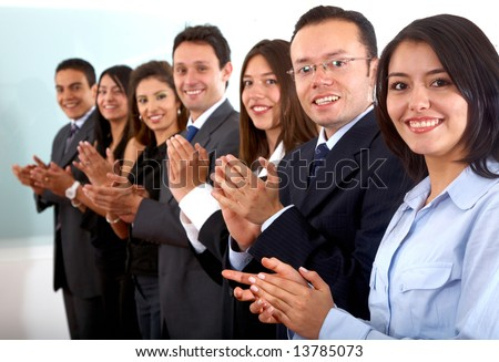 business team clapping a good presentation in an office - stock photo