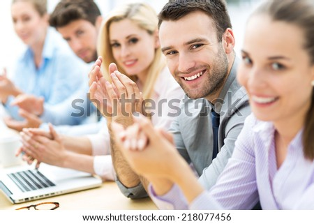 Business team clapping in applause - stock photo