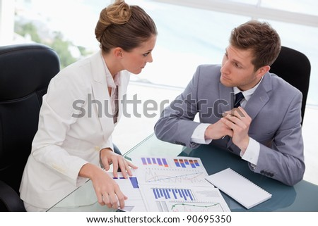 Business team deliberating on market research results - stock photo