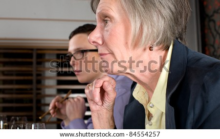 Business team discussing matters over a Japanese themed lunch. - stock photo