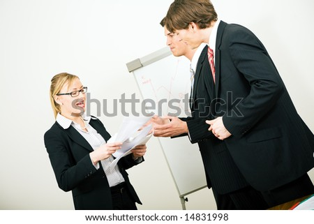 Business team discussing some things that went wrong it seems - stock photo