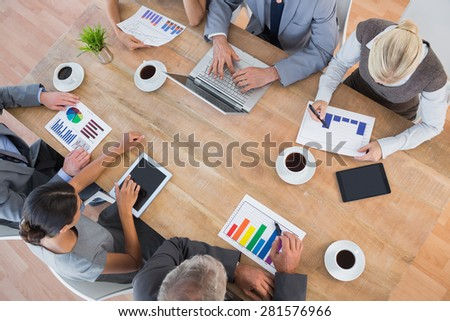 Business team discussing the graphs in the office - stock photo