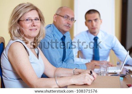 Business team during meeting, conference room shoot - stock photo