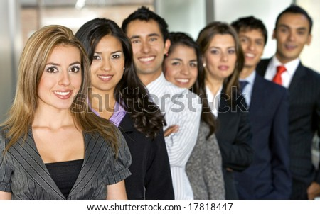 Business team full of young entrepreneurs with a beautiful girl leading