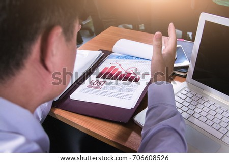 Business team hands at working with financial plan and a tablet on office desk