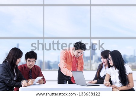 Business team having meeting at the office - stock photo