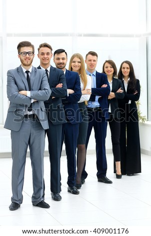 Business team in a line smiling at the camera - stock photo