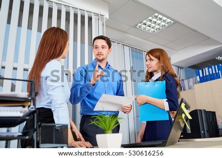 Business team in an office communicating with documents their