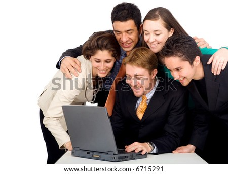 business team in an office laptop computer - meeting - stock photo