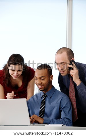 business team in an office on a laptop