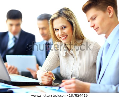 Business team interviewing young applicant in bright office - stock photo