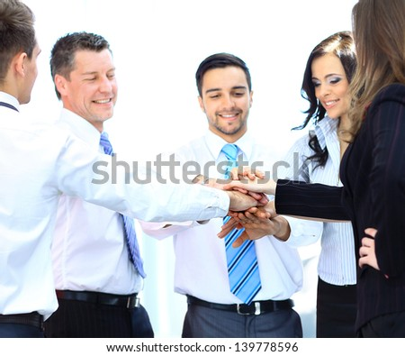 Business team joining hands together - stock photo