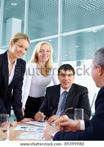Business team listening to their business leader