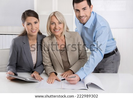 Business Team: Man and woman group in a meeting talking about facts and solutions. - stock photo