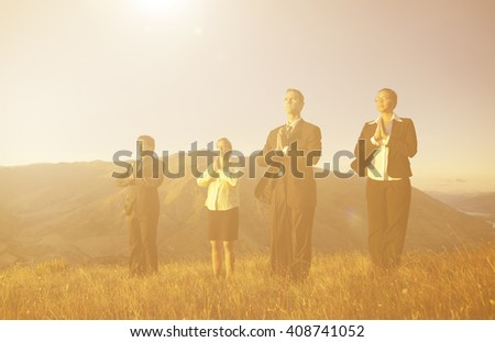 Business team meditating on Top of the mountains. - stock photo