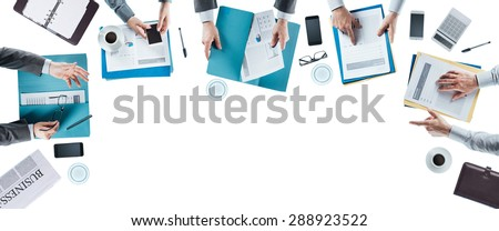 Business team meeting and working at office desk, hands top view, unrecognizable people, blank copy space - stock photo