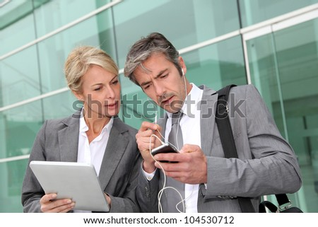 Business team meeting outside with tablet - stock photo