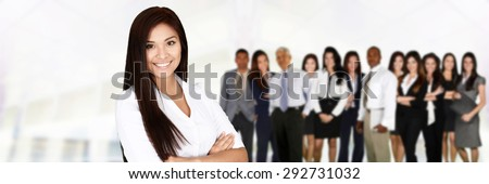 Business team of all races working together in an office - stock photo