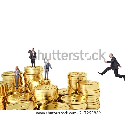business team on golden bitocoin - stock photo