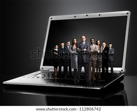 business team on laptop - stock photo