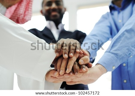 Business team overlapping hands - stock photo