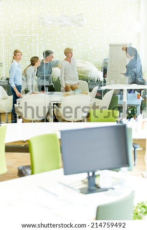 Business team planning a strategy during a meeting in the office - stock photo