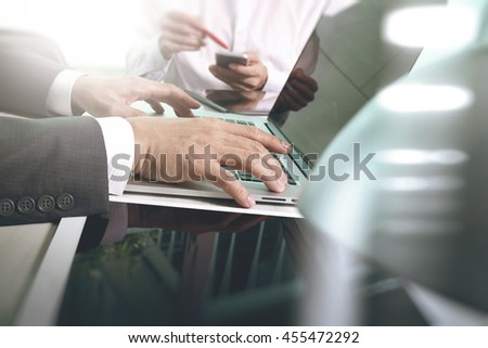 Business team present. Photo professional investor working with new startup project. Finance managers meeting.Digital tablet laptop computer design smart phone using.Sun flare effect