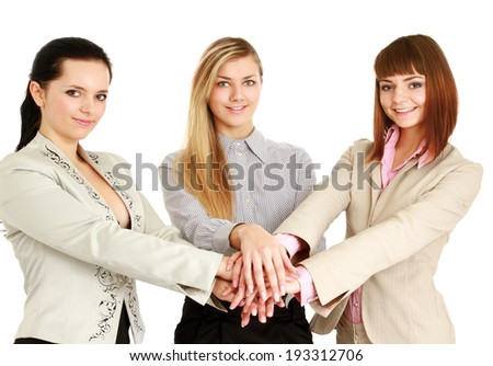 business team putting their hands - stock photo