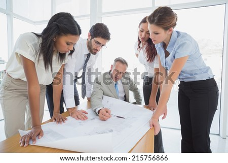 Business team reading work plans in the office - stock photo