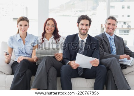 Business team reviewing work notes while sitting - stock photo