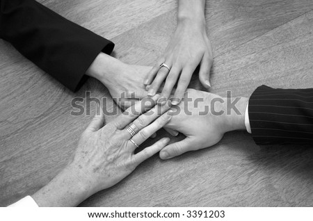 Business team's hands together.